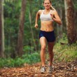 Stock Photo: Woman Running in the Forest