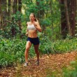 Woman Running in the Forest - Stok fotoğraf
