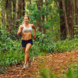 Woman Running in the Forest — Stock Photo #11608264