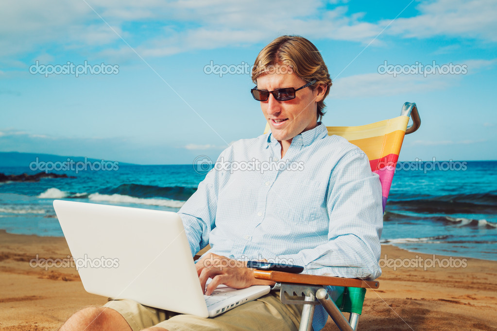 Young Business Man Working Remotely on Tropical Beach — Stock Photo #11608116
