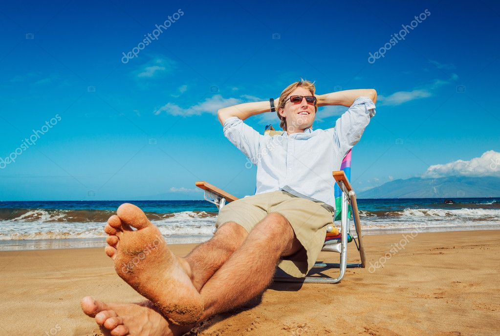 Young Business Man Relaxing on Tropical Beach — Stock Photo #11608156