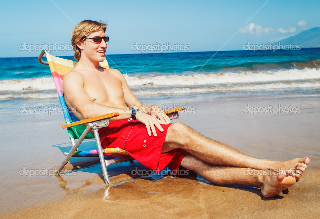 Young Handsome Man Relaxing on Tropical Beach  Stock Photo #11608164