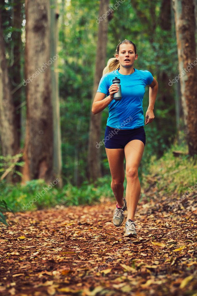 Attractive Young Woman Running in the Forest — Stock Photo #11608244