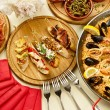 Dinner with paella — Stock Photo