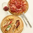 Stock Photo: Tapas and prosciutto