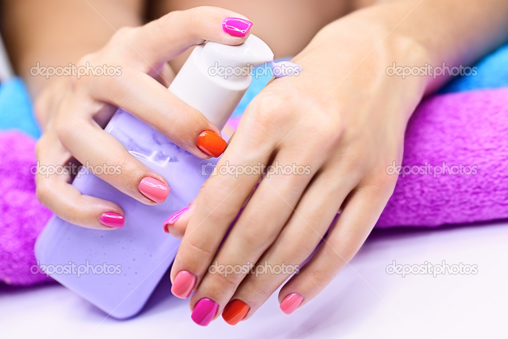 Care cream for women's hands with a manicure — Stock Photo #11167744