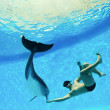 Man and dolphin — Stock Photo