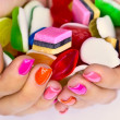 Candys in hands — Stock Photo