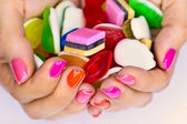 Candys in hands — Foto de Stock