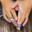 Nails with ribbons — Stock Photo