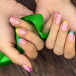 Manicures and ribbon — Stock Photo