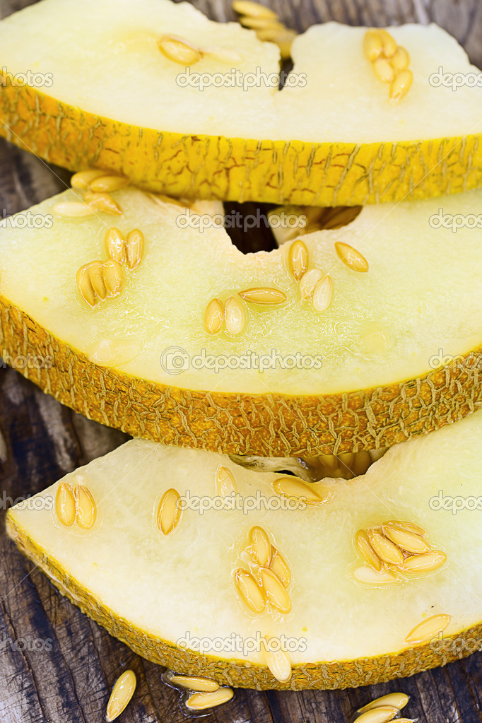 Slices of sweet and ripe melon on a wooden board  Foto de Stock   #11751070