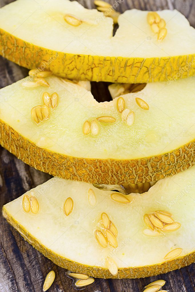 Slices of sweet and ripe melon on a wooden board — Foto Stock #11751070
