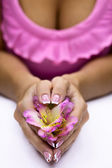 Freesia in hands — Stock Photo