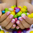 Candies in hands — Stockfoto