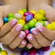 Candies in hands - Stock Photo
