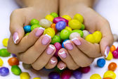 Candies in hands — Stok fotoğraf