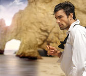 Formal man on beach — Stock Photo