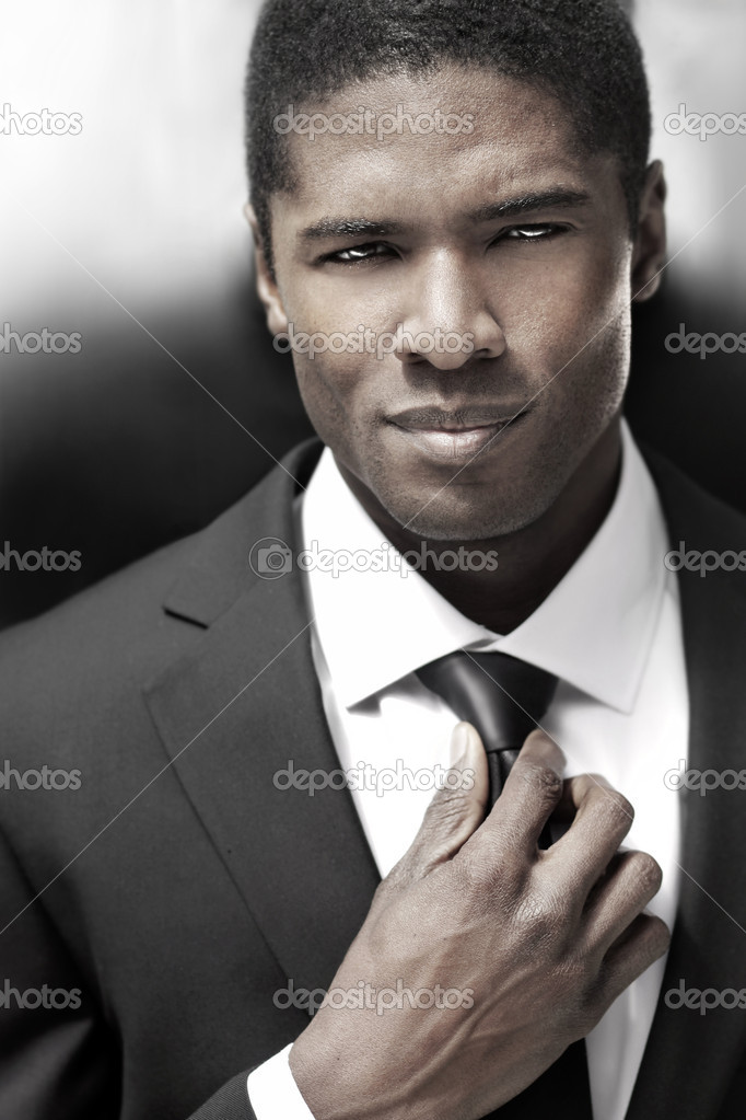 Sexy young stylish businessman in black and white suit — Stock Photo #11382549