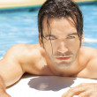 Hot sexy guy in pool — Stock Photo