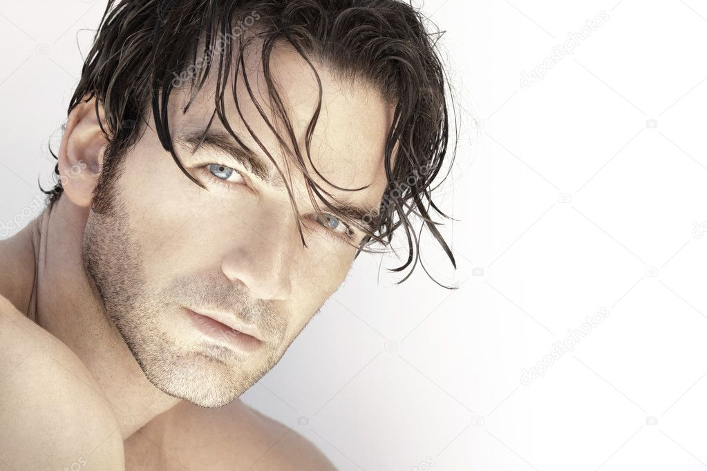 Close up portrait of a beautiful sexy male model face against white background — Stock Photo #11645440