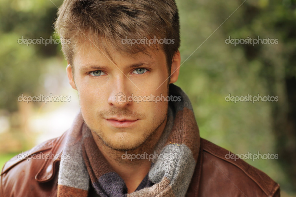 Young handsome man outdoors in fall clothing with autumn natural surroundings — Stock Photo #12035861