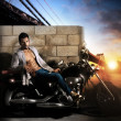 Sexy man on motorcycle - Stock Photo