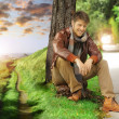 Young man in autumn - Stock Photo
