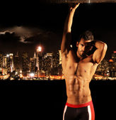 Sexy stud at night in the city — Stock Photo