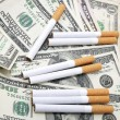 Stock Photo: Cigarettes and money