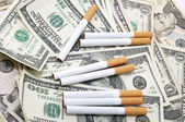 Cigarettes and money — Stock Photo