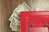 Money and a box for storage — Stock Photo