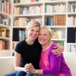 Mother and daughter hugging, looking at camera — Stock Photo