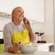 Retired woman preparing food at home — Stock Photo