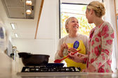 Mom and daughter cooking in home kitchen — Stock Photo