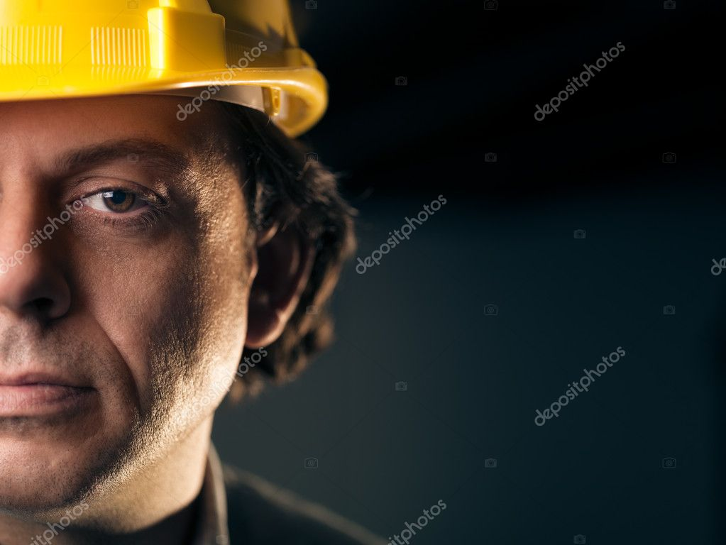 Portrait of serious middle aged man working as construction worker with hardhat. Copy space — Stock Photo #11084444
