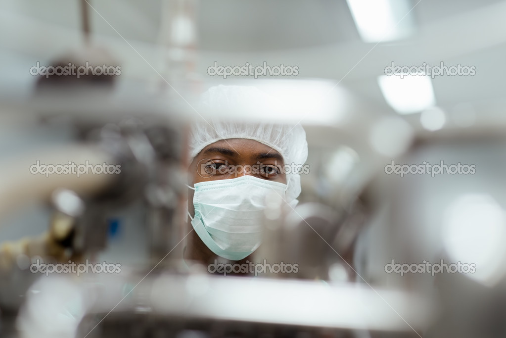 Lab technician working as researcher in biotechnology plant with machinery  Stock Photo #11084517