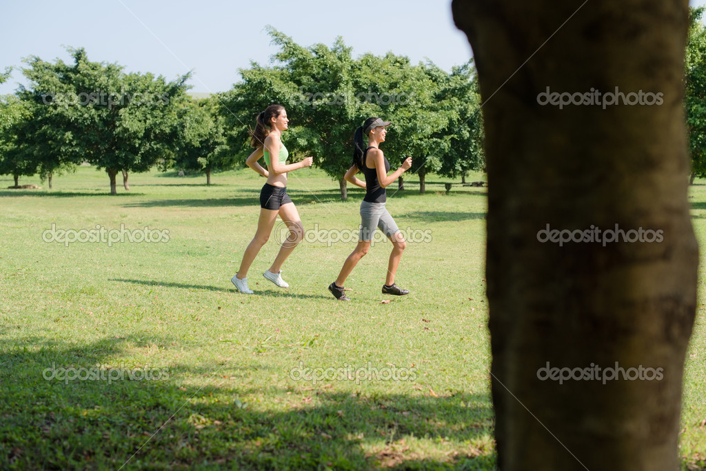 Sports and fitness with two female teenagers exercising in city park — Stock Photo #11433801