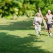 Active senior jogging in city park — Stock Photo