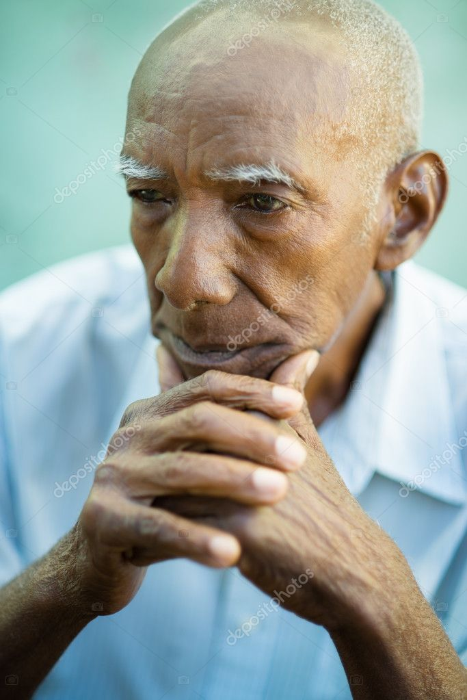Seniors portrait of contemplative old african american man looking away. Copy space — Stock Photo #11444265