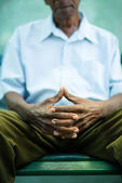 Pensive old man sitting on bench in park — Stock Photo