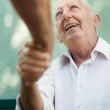 Group of happy elderly men laughing and talking — Stock Photo