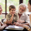 Happy parents and grandparents with boy in bar - Stock Photo