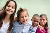 Happy children hugging, smiling and having fun — Stock Photo