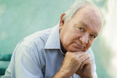 Portrait of sad bald senior man looking at camera — Stockfoto