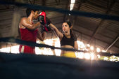 Young woman at boxing and self defense course — Stock Photo