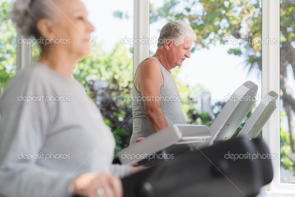 And sports, elderly couple working out on treadmill in fitness gym  Stock Photo #11893474