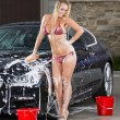 Girl Washing Car — Stock Photo #11616563