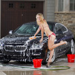Stock Photo: Girl Washing Car