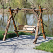 Stock Photo: Wooden swing on lake